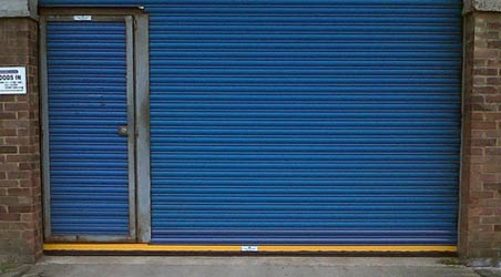 Roller shutter repairs on a damaged door