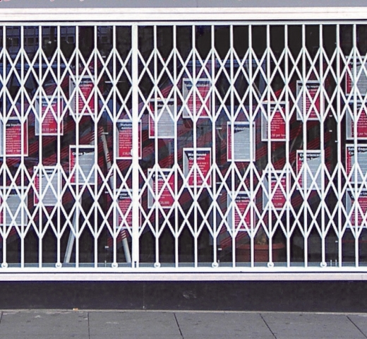 Retractable grille over shop front